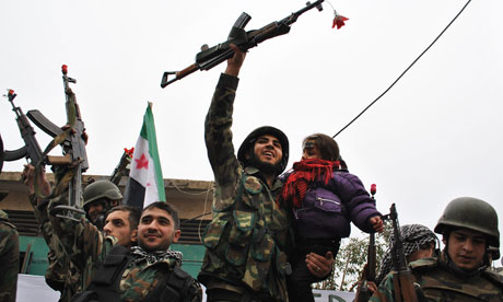 Syrian army defectors join anti-regime protesters in Homs province, January 2012